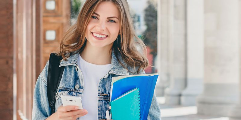 College student with books in her hand