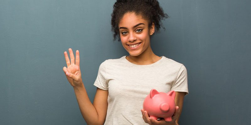 College student with piggy bank in her hand