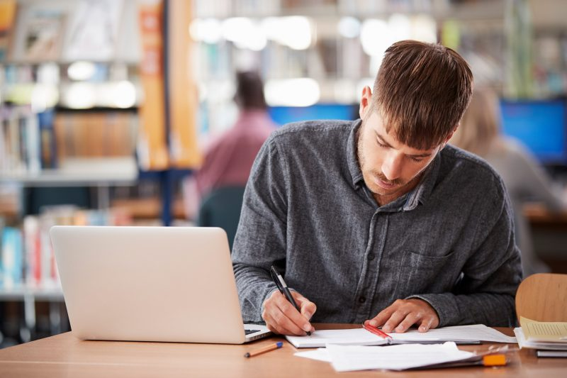 College student working on scholarship essay