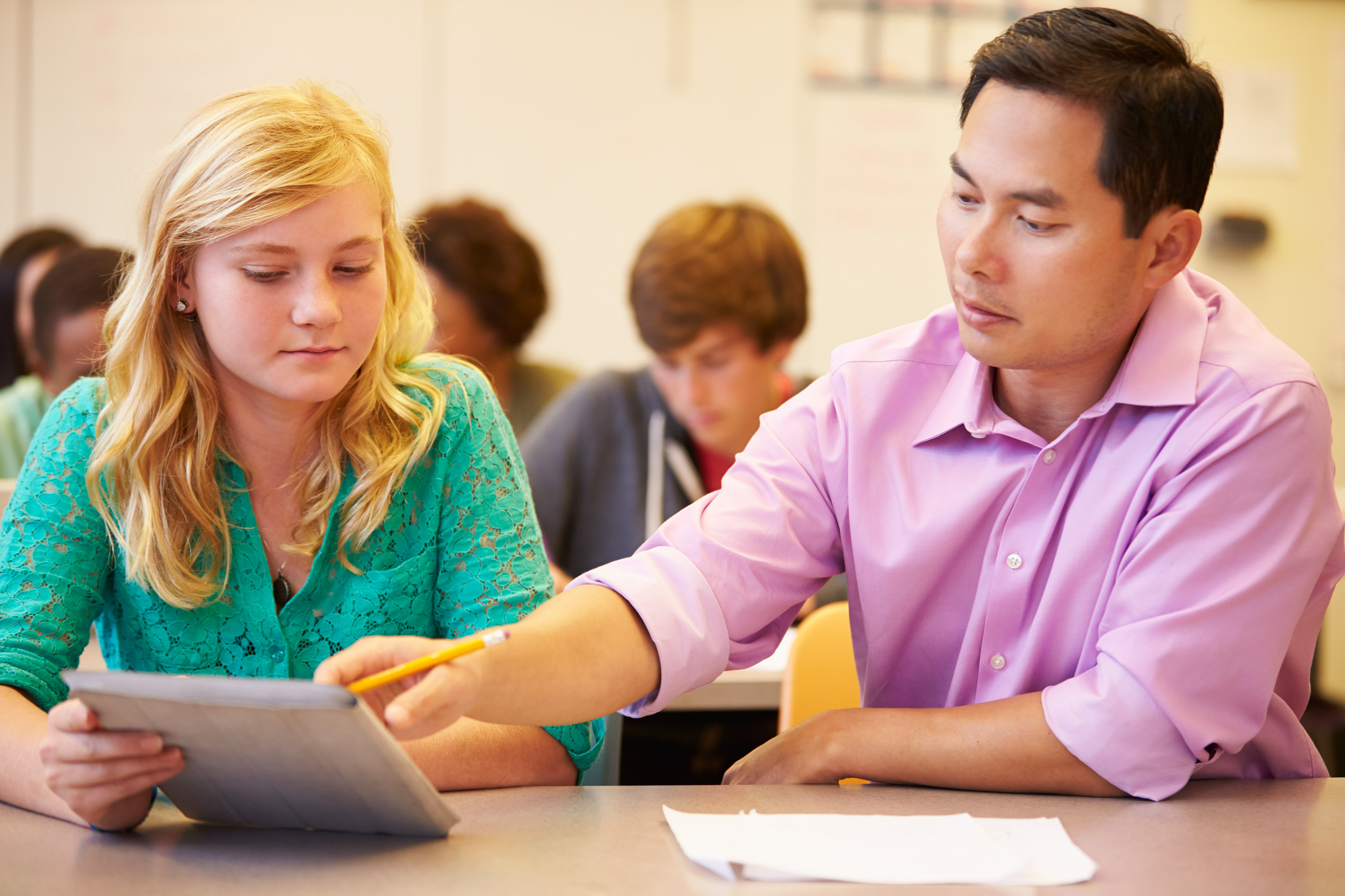 Teacher helping student with coursework