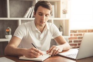 Student writes personal statement for college
