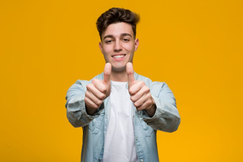 College student giving thumbs up for scholarship